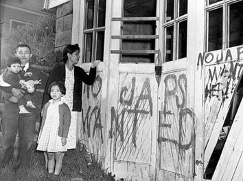 conclusion ese internment democracy or discrimination   a ese family returns home to their garage vandalized graffiti and broken windows in seattle on 10 1945 ap photo
